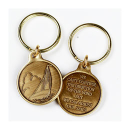"Change the Sails Key Ring Charm Front features sailboat image, and back reads, ""I can't control the  wind,  I can only adjust my sails."""
