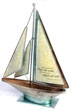 "Metal Tabletop Sailboat Crafted of painted iron metal, this unique piece of art includes the famous Bertha Calloway quote, ""We cannot direct the wind, but we can adjust our sails."""