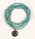 Serenity Beaded Wrap Bracelet </br>The turquoise beads and feather charm on this bracelet remind us that there is daring, strength, and peace in letting go.</br>