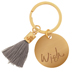 "Wish Keychain </br>Keep your wishes close with this ""Wish""-engraved 1 inch gold keychain with a decorative grey tassel.</br>"