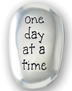 One Day at a Time Stone </br>Carry a One Day at a Time stone--or all three--with you wherever you go as a daily reminder to help you to be strong and courageous, find your serenity, and take one day at a time. Approximately 1-1/2 inch.</br>