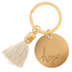 "Hope Keychain </br>Hope is never far away with this ""Hope""-engraved 1"" gold keychain with a decorative white tassel.</br>"